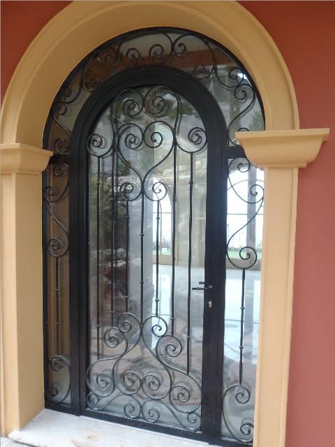 Porte vitrée volutes 2